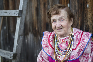 Old woman in a bright national clothes outdoors.