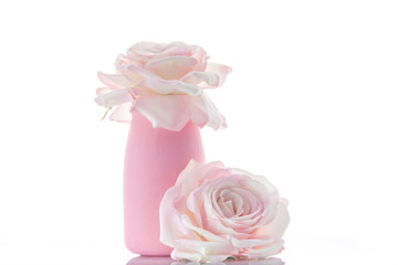 Two pink artificial roses with vase