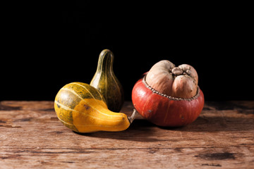 Gourds on wooden table