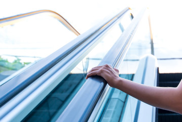 hands on Escalator to a better future