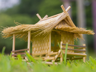 toy bamboo hut on green grass