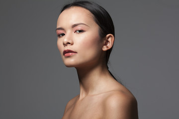 young brunette woman with natural make up and perfect skin
