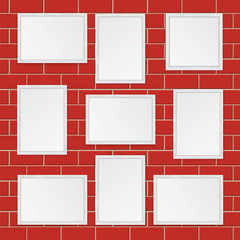Set of  wooden frames isolated on the wall of red bricks