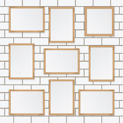 Set of  wooden frames isolated on the wall of white brick