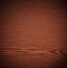 braune Holzmaserung mit Vignette.
