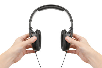Headphones in hands on a white background