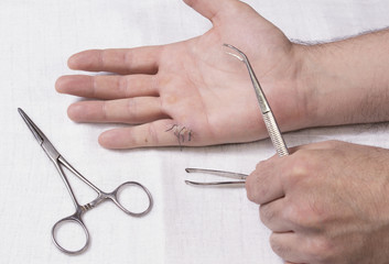 Mans hands with medical instruments