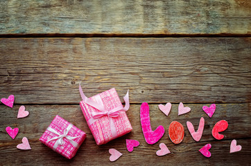 Valentine's background with gift and word Love