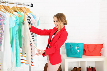 Keuken foto achterwand Magische wereld Young girl in shop buying clothes