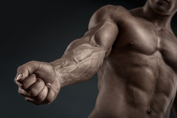 Close-up of athletic muscular arm and torso Wall mural
