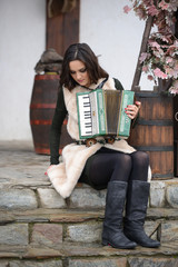 Beautiful woman with playing accordion