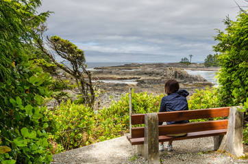 Woman Hiker on a Bench Enjoying the Scenery