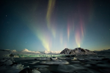 Northern Lights above the Arctic mountains and glacier