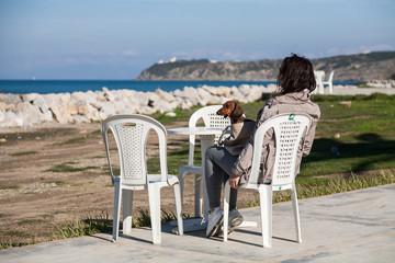 Women  with dachshund dog