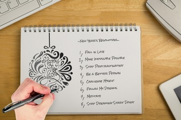 Composite image of hand writing with a pen