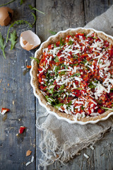 red peppers tart with rocket and parmesan on quiche mold