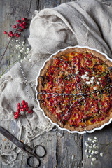 baked red peppers tart on quiche mold on rustic table