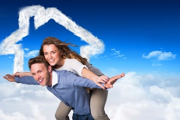 Composite image of smiling young man carrying woman