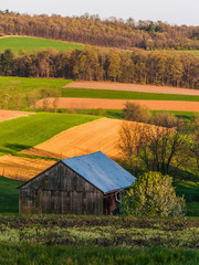 Rolling hills, farm fields, and a barn in Southern York County,