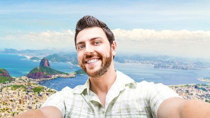 Happy young man taking a selfie photo in Rio de Janeiro, Brazil