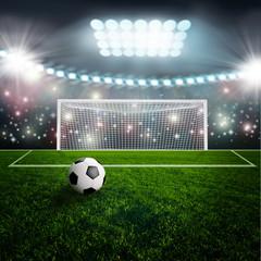 Soccer ball on green stadium arena