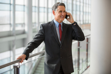 Elder business man calling by phone at the airport