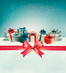 Christmas background with a bow and presents. Vector.