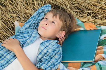 Teenage boy lying and dreaming inspired by book