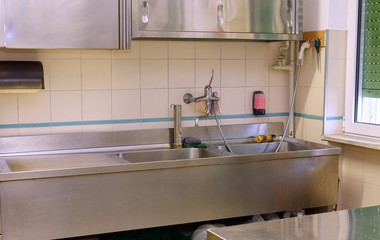 sink and the Workbench in an industrial kitchen in the school ca