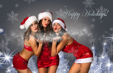 Happy Holidays postcard.Three Sexy Santa's Helpers blowing snow