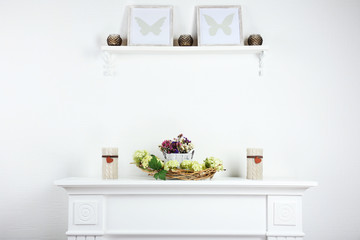 Stylish shelves with candles and frames