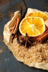 Tuinposter Plakjes fruit Christmas spices and baking ingredients on wooden background