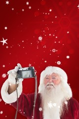 Composite image of santa claus makes a selfie