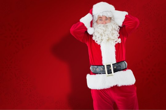Composite image of stressed santa with his hands on head