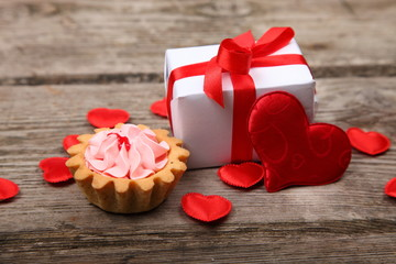 Holidays gift, cake and red heart