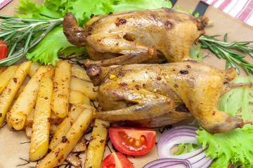 appetizing fried woodcock with potato and fresh vegetables