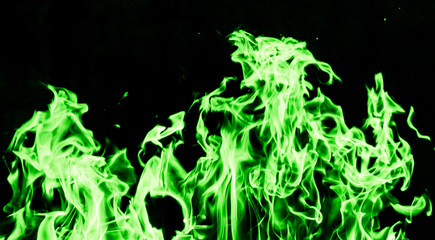 green flame fire on black background