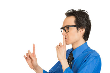 man placing finger on lips pointing to say shhh be quiet
