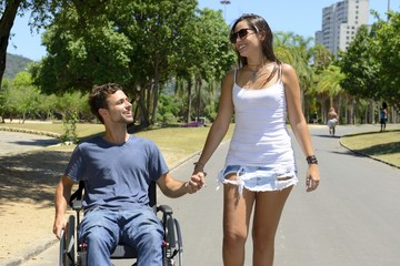 man in wheelchair and girlfriend