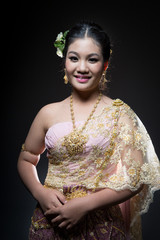 asian teen age female with traditional Thai suit in Studio