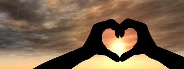 Conceptual heart shape sunset silhouette