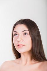 Beautiful brunette on white background. Beauty photo.