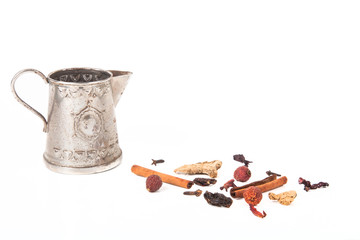 set for mulled wine and antique teapot for brewing on a white ba