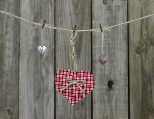 Red checkered heart and locks hanging on clothesline