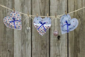 Blue fabric hearts and locks hanging on clothesline