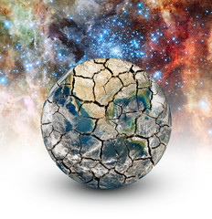 Cracked Earth on the background of the starry sky.