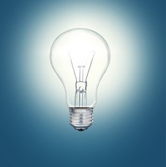 A light bulb shines in the darkness bright light