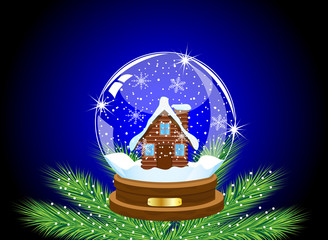 glass festive ball with a house inwardly