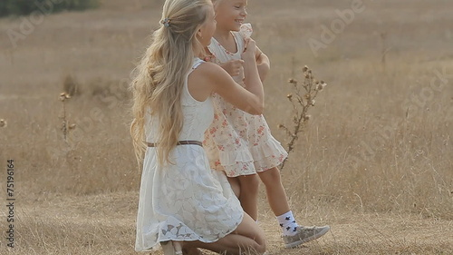 """Mom amuses her little daughter(娘), hugging and kissing her"" Stock footage and royalty-free videos on Fotolia."