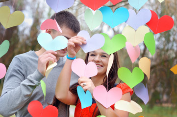 couple in love on Valentine's Day in the Park with hearts